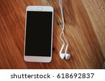 smart phone on wooden table... | Shutterstock . vector #618692837