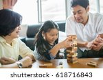 asian family playing jenga game ... | Shutterstock . vector #618716843