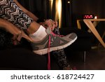 Small photo of Sportswoman tie shoelaces to be ready for jogging with tracksuit and running shoes. Woman tying a shoelace and preparing for fitness.