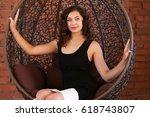 beautiful girl in black evening ...   Shutterstock . vector #618743807