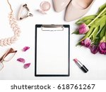 blank paper mock up and woman's ... | Shutterstock . vector #618761267