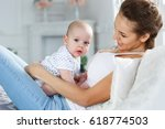 young mother playing with 5... | Shutterstock . vector #618774503
