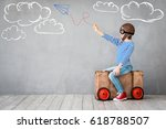 child pretend to be pilot. kid... | Shutterstock . vector #618788507