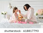 mother is doing make up her...   Shutterstock . vector #618817793