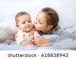 girl kissing little sister. the ... | Shutterstock . vector #618838943