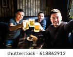 three young men in casual...   Shutterstock . vector #618862913
