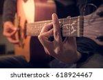 a man playing a guitar ... | Shutterstock . vector #618924467