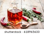 oil in carafe with spices and... | Shutterstock . vector #618965633