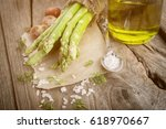 fresh green asparagus with... | Shutterstock . vector #618970667