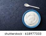 greek yogurt in blue bowl on... | Shutterstock . vector #618977333