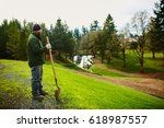 landscaper looking out over his ... | Shutterstock . vector #618987557
