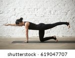 young yogi attractive woman... | Shutterstock . vector #619047707