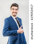 young attractive man in a blue... | Shutterstock . vector #619052417