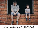 portrait of young sad little... | Shutterstock . vector #619053047