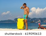 young tourist man is standing... | Shutterstock . vector #619090613
