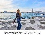 woman walking in venice italy.... | Shutterstock . vector #619167137