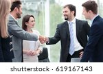 two business people shaking... | Shutterstock . vector #619167143