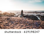 woman walking along ocean walk | Shutterstock . vector #619198247
