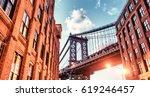 brooklyn bridge seen among city ... | Shutterstock . vector #619246457