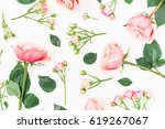 Stock photo floral pattern with pink roses and leaves on white background flat lay top view 619267067