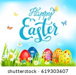 bright easter eggs on grass.... | Shutterstock .eps vector #619303607