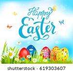 bright easter eggs on grass.... | Shutterstock .eps vector #619303607