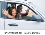 happy multiracial couple on car ... | Shutterstock . vector #619310483