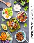 mixed healthy vegetarian salads ... | Shutterstock . vector #619311677