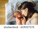 mother with newborn baby... | Shutterstock . vector #619317173