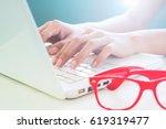 female hand using laptop ... | Shutterstock . vector #619319477