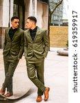 american businessman looking at ... | Shutterstock . vector #619359917