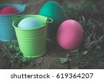 Easter Eggs In Colored Buckets