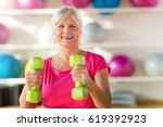 senior woman at the gym  | Shutterstock . vector #619392923
