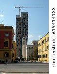 Small photo of TIRANA, ALBANIA - SEPTEMBER 27: Orthodox Cathedral is overshadowed by new high-rise construction, Tirana, Albania on September 27, 2016.