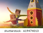 children in astronauts costumes ... | Shutterstock . vector #619474013