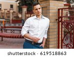 stylish young man in a white... | Shutterstock . vector #619518863