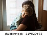 the sad kid on hands at his...   Shutterstock . vector #619520693