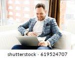 happy businessman smiling...   Shutterstock . vector #619524707