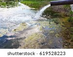sewage drains into the river ... | Shutterstock . vector #619528223