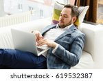 businessman lies on a white... | Shutterstock . vector #619532387