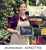 woman owner fresh grocery... | Shutterstock . vector #619627703