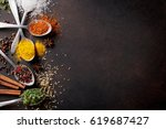 various spices spoons on stone... | Shutterstock . vector #619687427