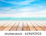 empty wooden table with party... | Shutterstock . vector #619692923