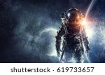 astronaut in outer space. mixed ... | Shutterstock . vector #619733657