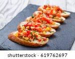 appetizer bruschetta with... | Shutterstock . vector #619762697