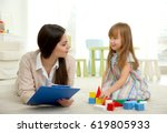 young child psychologist...   Shutterstock . vector #619805933
