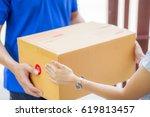 asian woman receiving a package ... | Shutterstock . vector #619813457