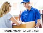 asian woman receiving a package ... | Shutterstock . vector #619813553