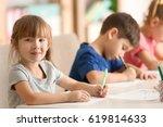 cute kids drawing in classroom   Shutterstock . vector #619814633