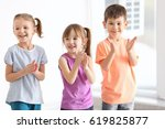 cute kids singing in music class | Shutterstock . vector #619825877